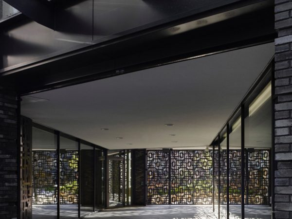 contemporary design of panels allowing outside light through modern building