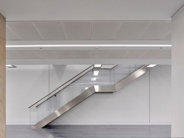 staircase with glass panels leading up to next level of new building in Waterloo