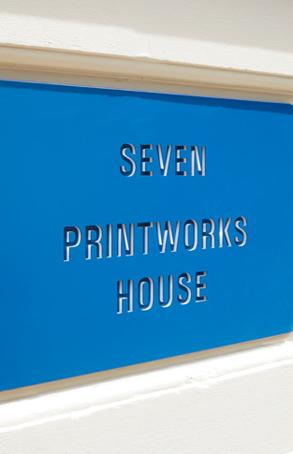 stencil design of 'SEVEN PRINTWORKS HOUSE' on blue