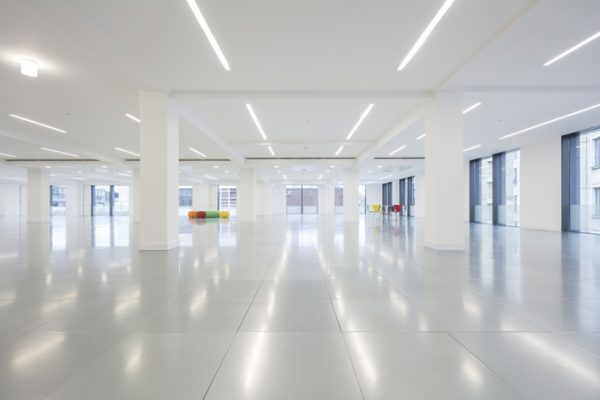 rows of overhead lights reflecting in the tiled floor beneath in this spacious office space in SE1