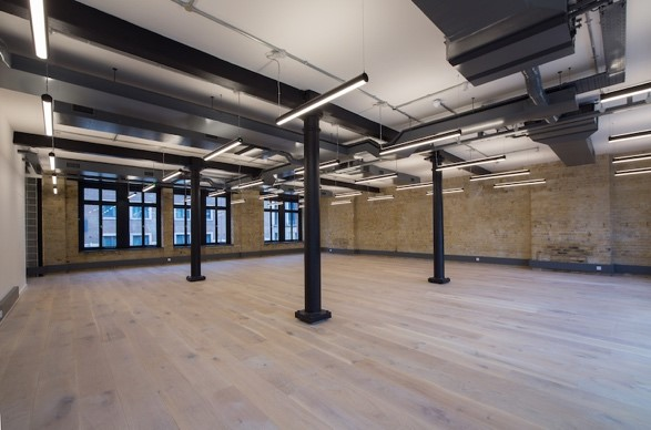 open serviced office space with exposed brick walls in SE1