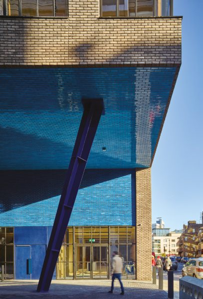 under the overhang with blue and brown bricks contrasting