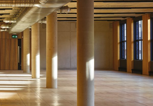 brown coloured workspace with long paper roll effect pillars and gold piping above