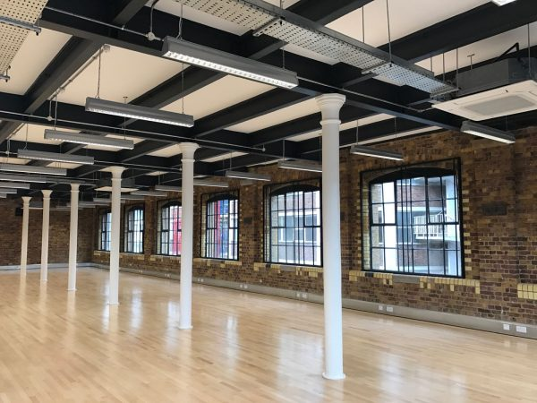 brick walls with square windows keep the factory feel at Metal Works