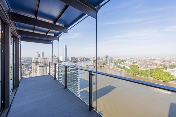 balcony from an upper floor with glass exteriors offer spectacular views over the River Thames