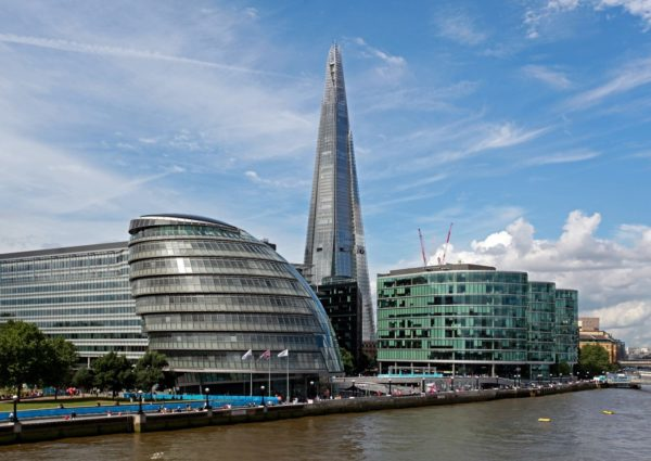 a summer's day view of the Shard and buildings on the banks of the river